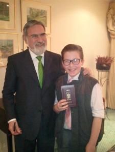 Ethan did not expect to receive a pat on the back and a siddur with a personal message from the Chief Rabbi